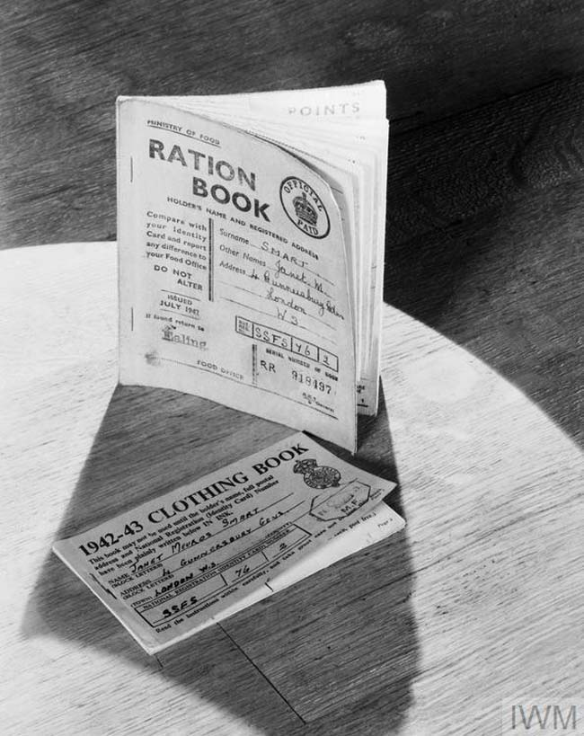 A photo of a ration book and clothing book on a table