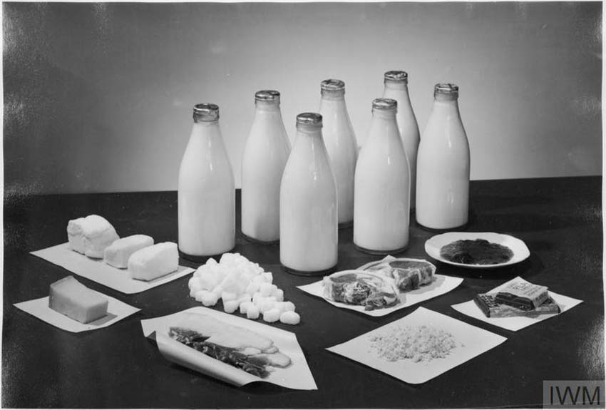 a photo of bottle of milk and meats and cheese and butter