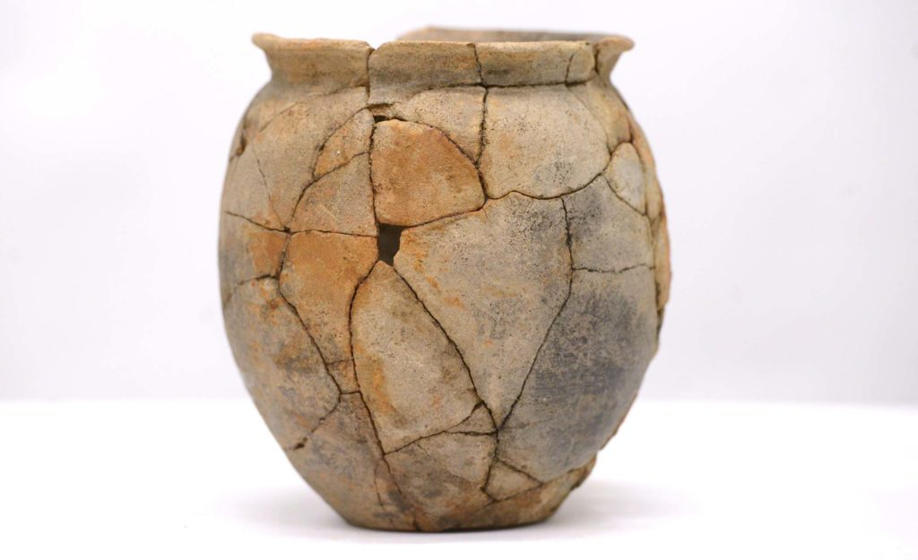 a photo of an urn pieced back together