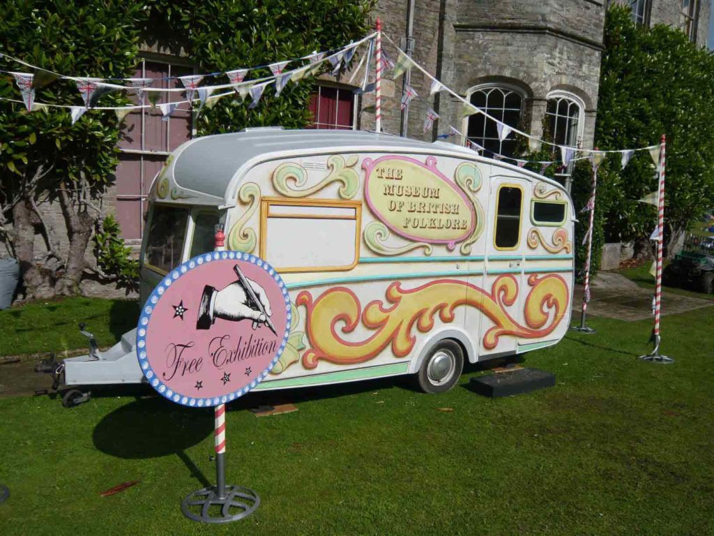 a photo of a caravan with circus style designs on the outside