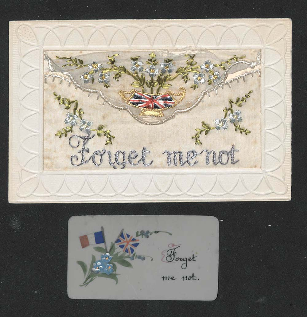 an embroidered card with the words forget me not