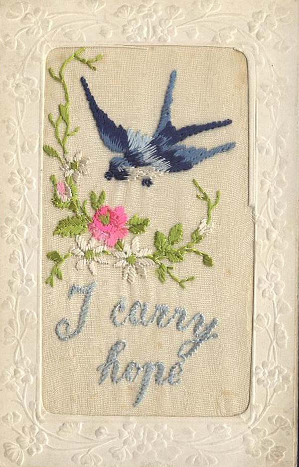 an embroidered postcard with a bluebird and the words I carry hope