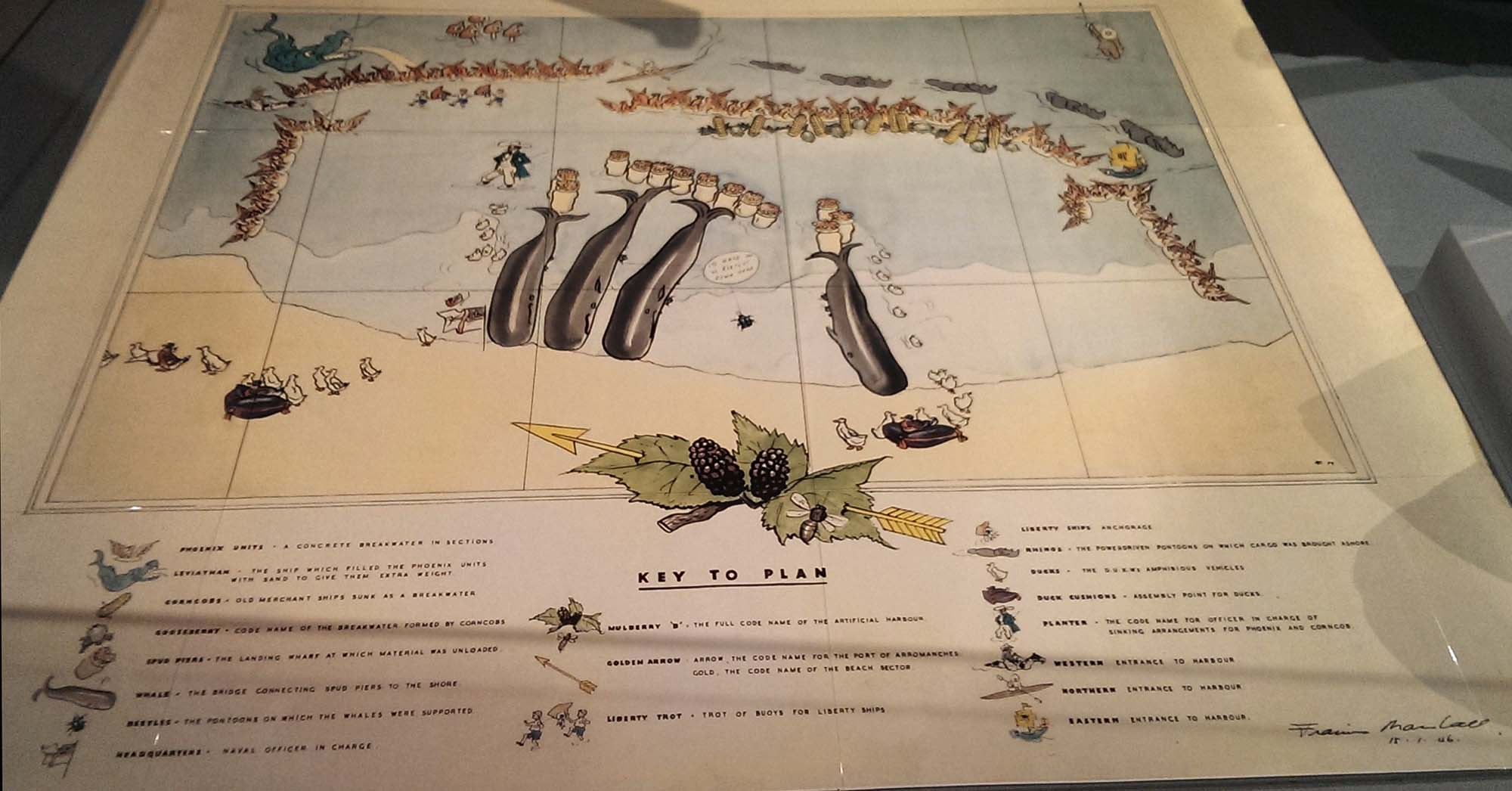 a photo of a cartoon printed map of the Mulberry harbours of D-Day with sea creatures represnting the harbours and barges etc