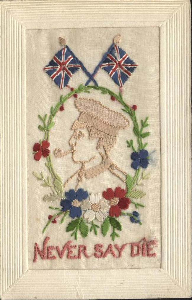 an embroiderd postcard with an image of a soldier smoking a pipe
