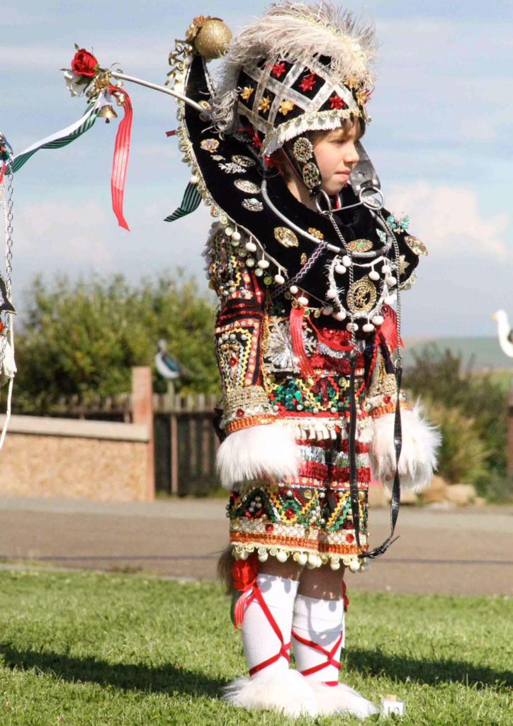 a photo of a child dressed in an elaborate outfit