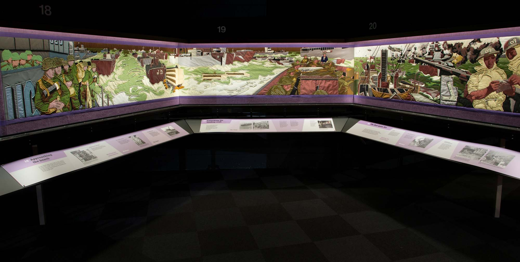 a photo showing several panels of the Overlord embroidery at the D-Day Story Museum