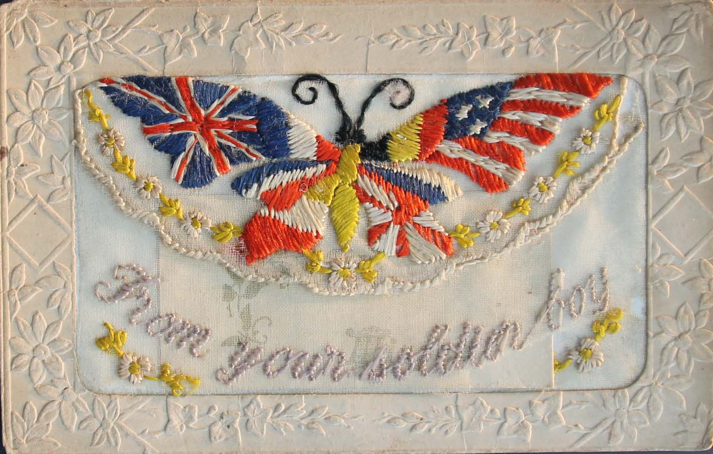 an emboridered card with a butterfly motif with British and American flags on its wings