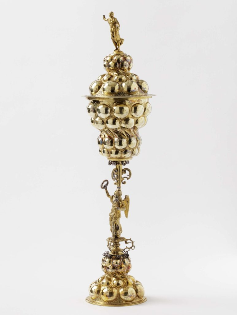 a photo of a large ornate cup with a candlestick-like base