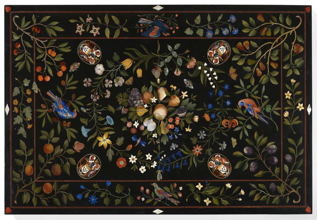 a photo of a tabletop inlaid with fruit, flower and parrot motifs