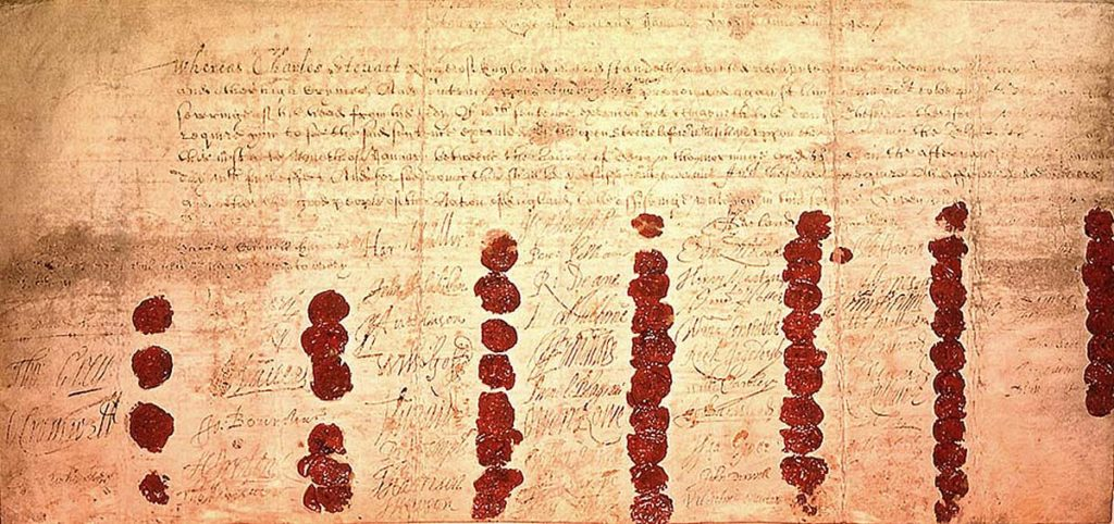 a photo of a document with signatures and seals all over it