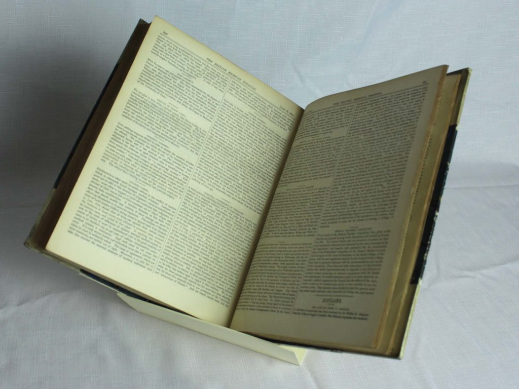 a photo of an open book with dense two columned text
