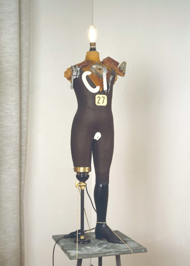 a photo of a sculpture featurring a one legged mannequin with no arms or head