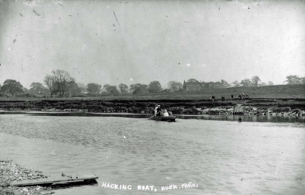 a photo of a river with a boat on the far bank
