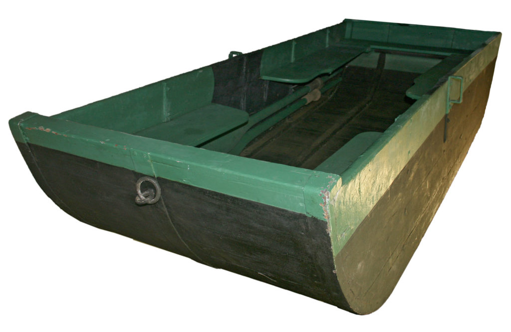 a photo of a green flat bottomed boat