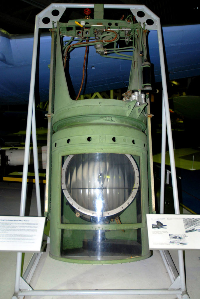 photograph of a large green lantern in a museum display
