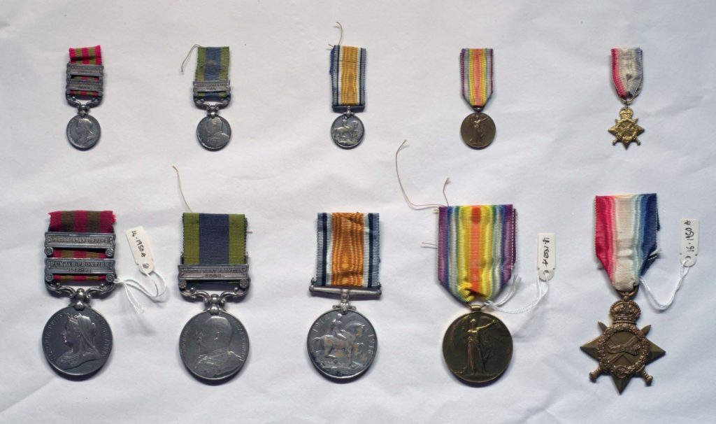 a photo of a series of Victorian and First World War medals photographed against white paper
