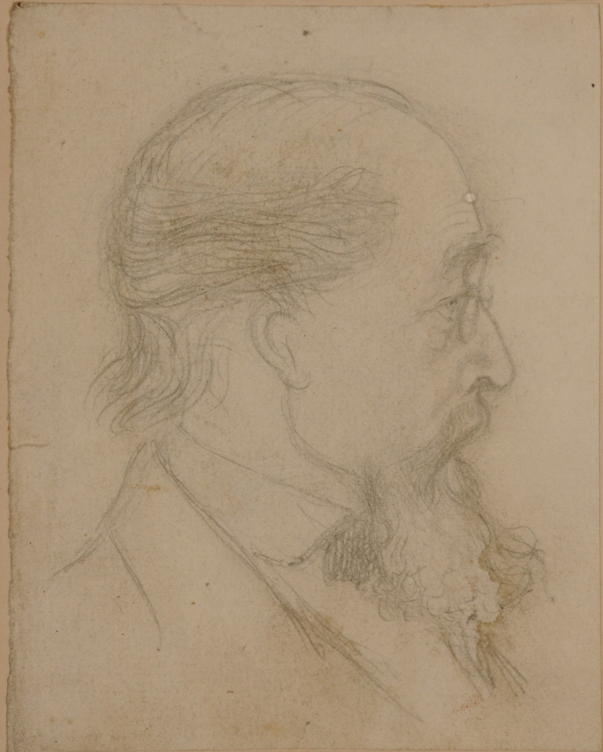 side in sketch of a man wearing spectacles with a big bushy beard