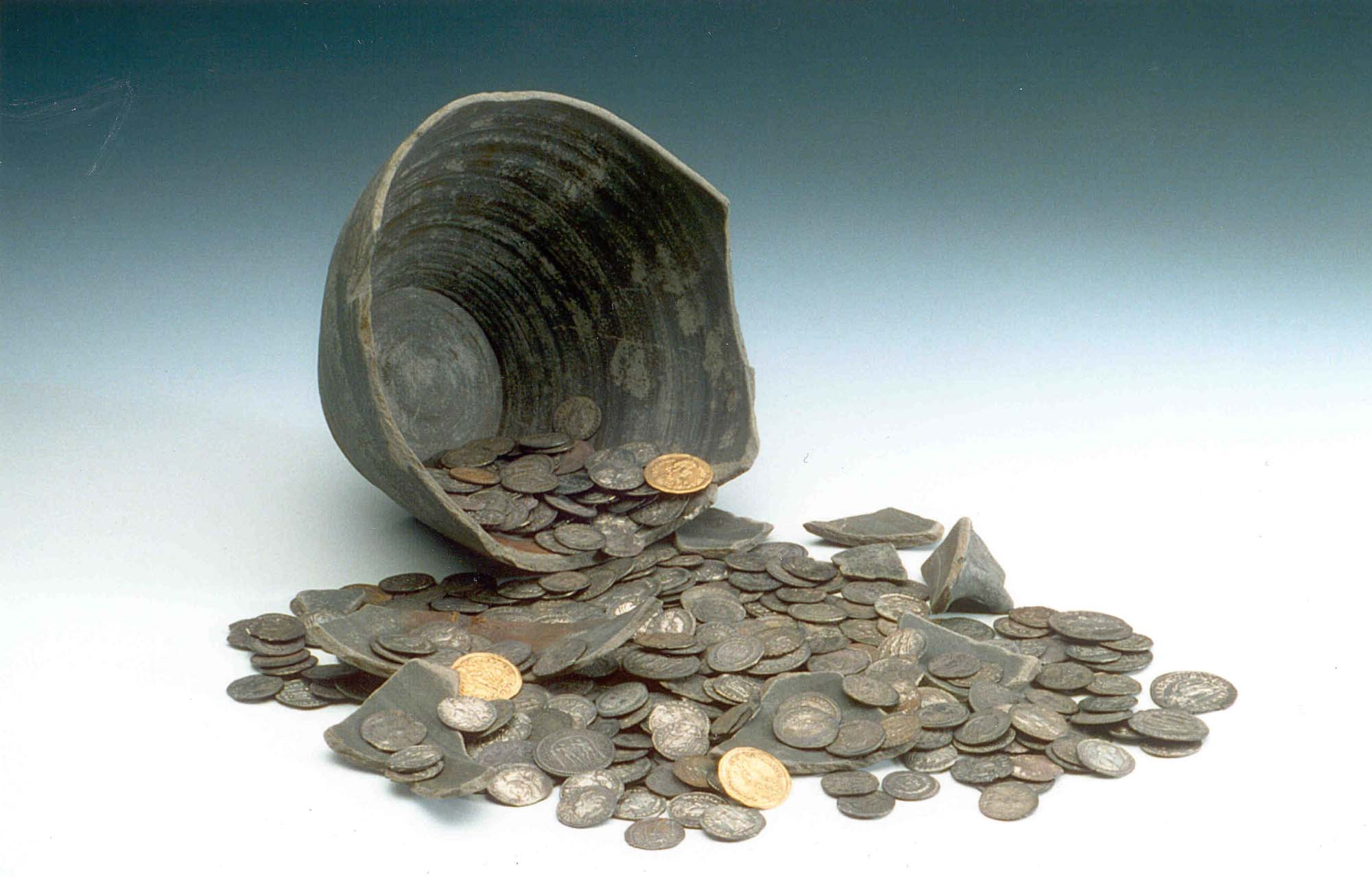 a photo of coins spilling out of a broken pot