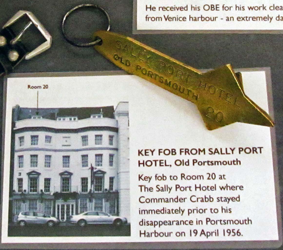a photo of a big brass hotel key fob