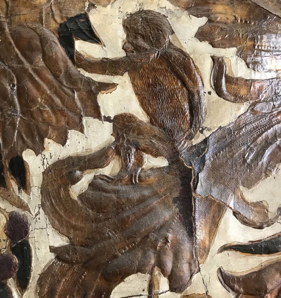 a close up of a monkey motif on wallpaper