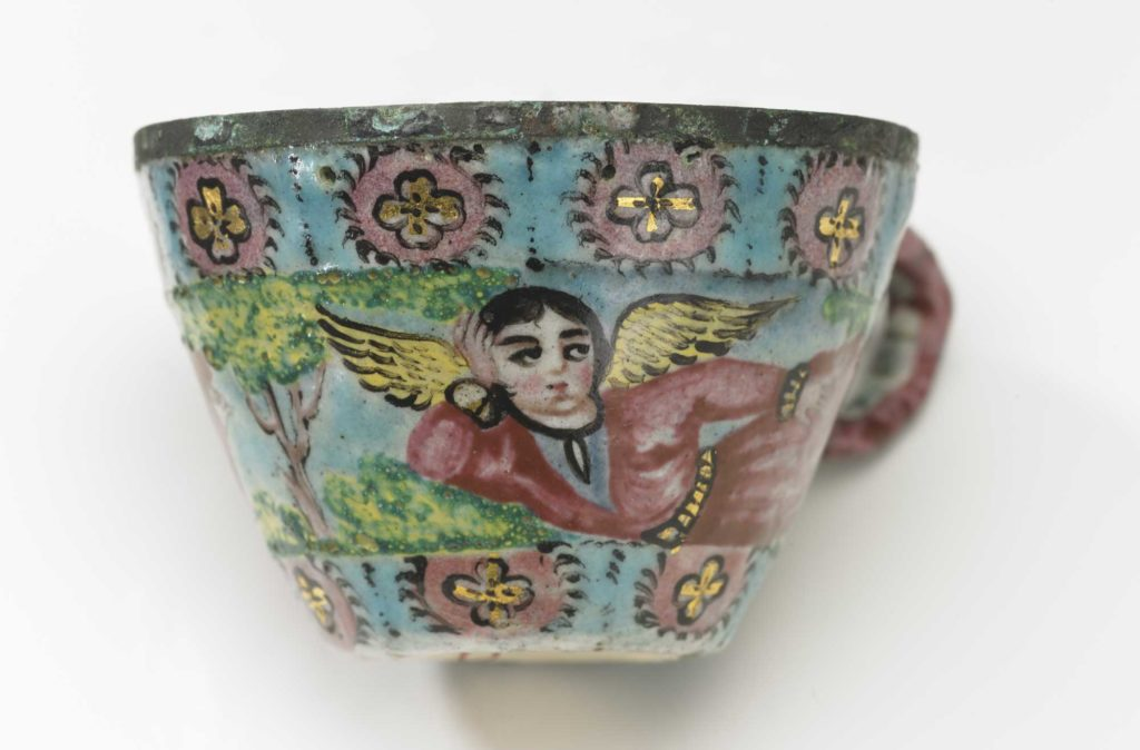 a photo of a teacup with an angel depicted on it