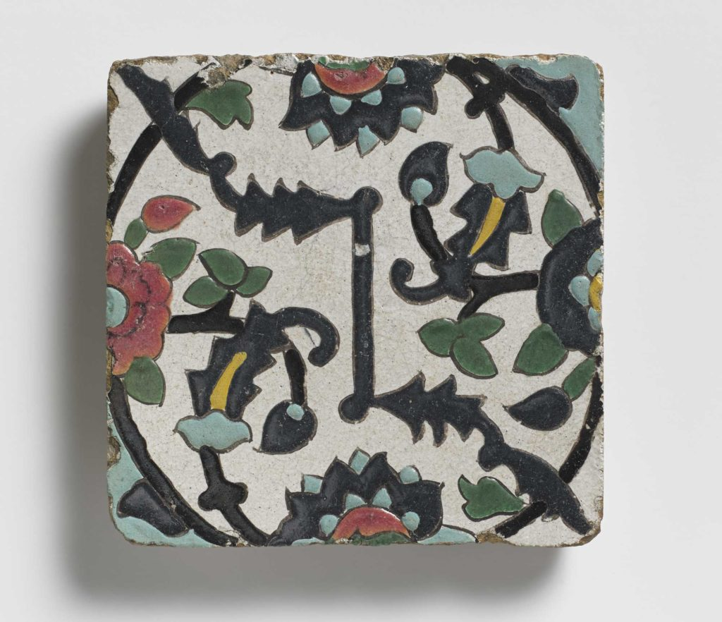 a photo of a decorated tile with floral motifs