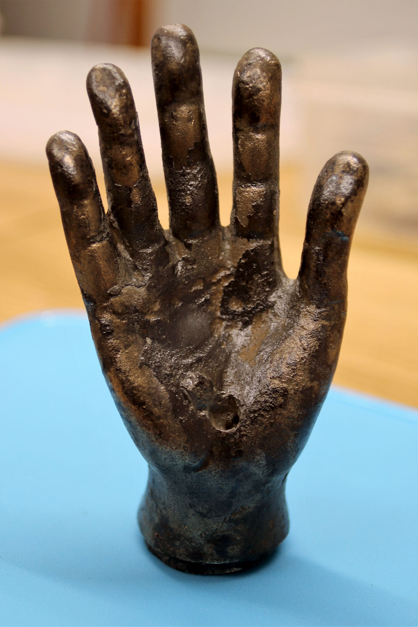 photograph of hand made from bronze