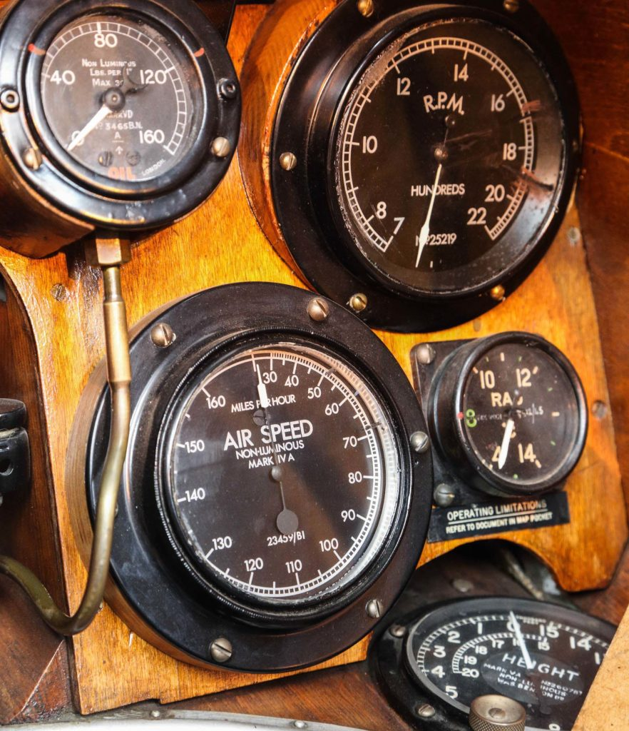 a photo of the dials and meters mounted on a walnut dashboard of the SE5A