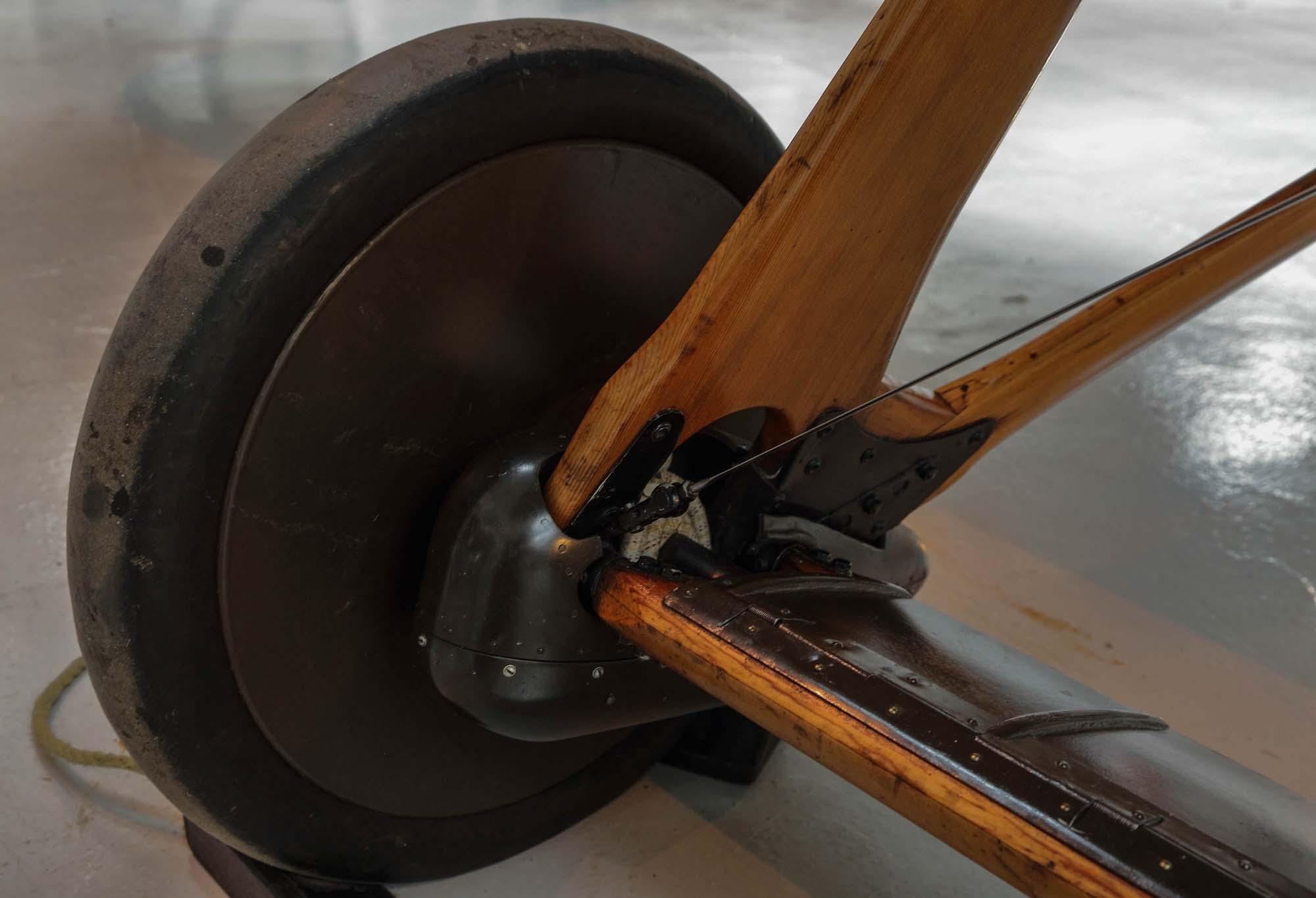 a photo of an aircraft's landing wheel and wooden landing gear