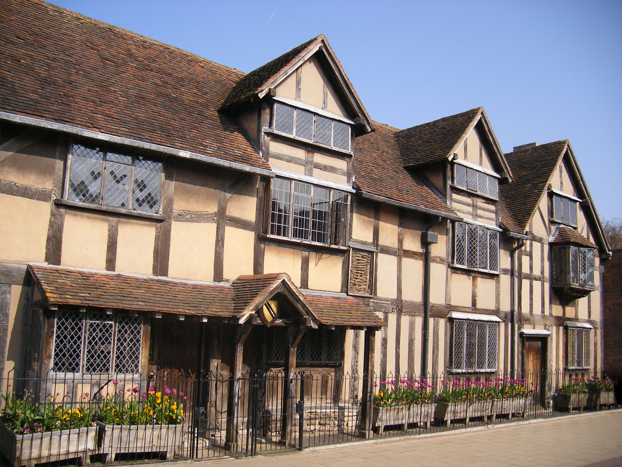 photograph of exterior of large tudor building