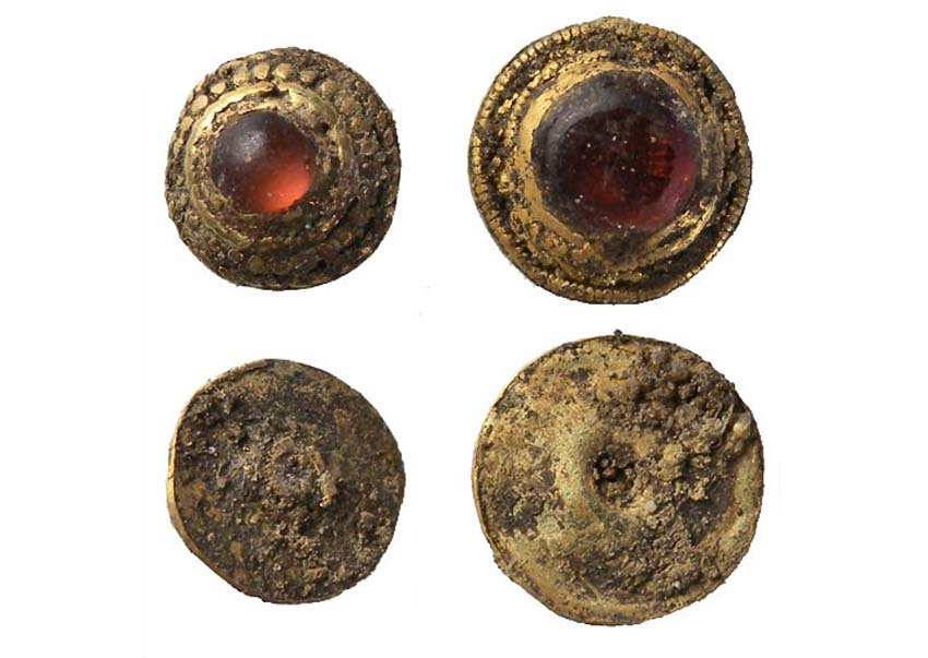 a photo of gold decorations inlaid with garnet