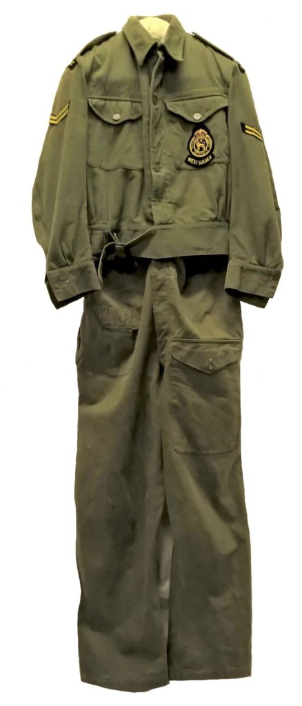 a photo of black battledress style uniform and trousers