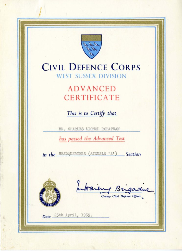 a photo of a certificate with the Civil Defence logo on it