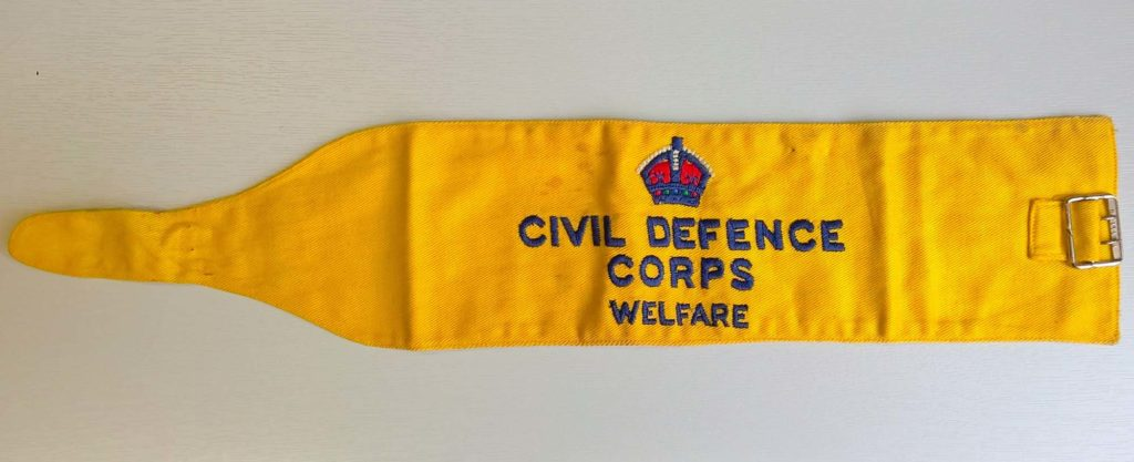 a photo of a yellow armbadn with the words Civil Defence Corps