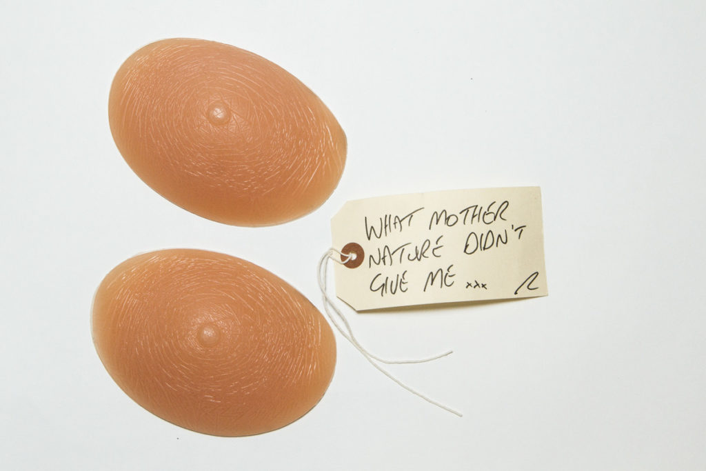 photograph of pair of 'chicken cutlet' bra insets with handwritten tag