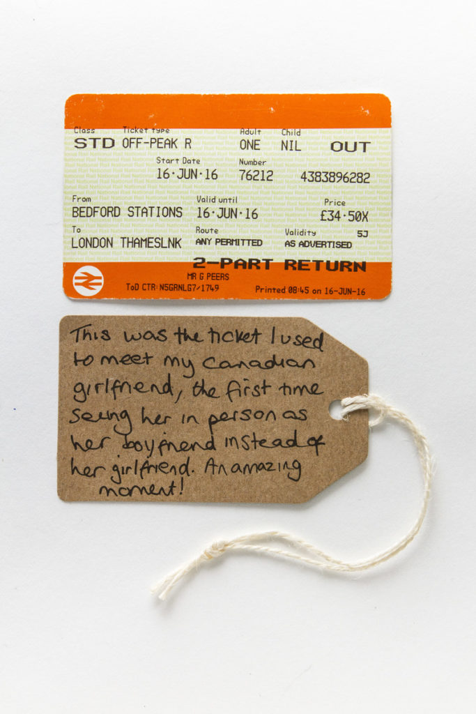 photograph of train ticket with brown handwritten tag