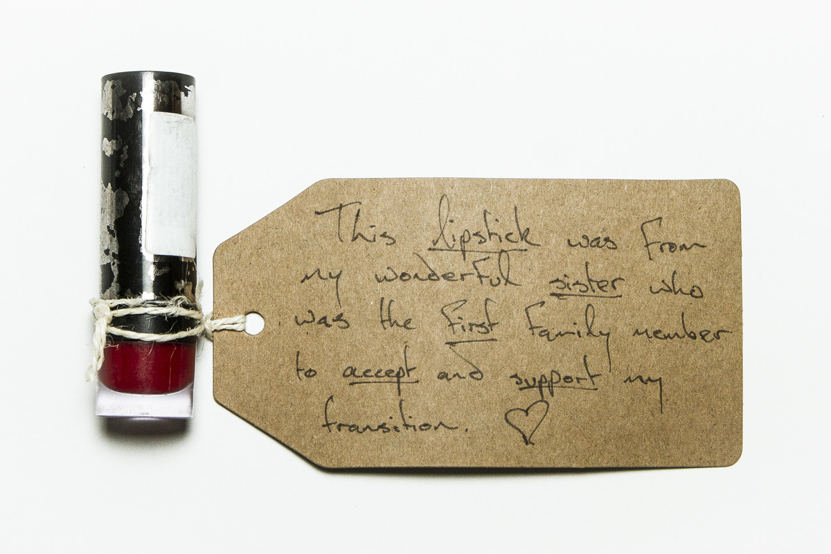 photograph of tube of lipstick with handwritten brown tag