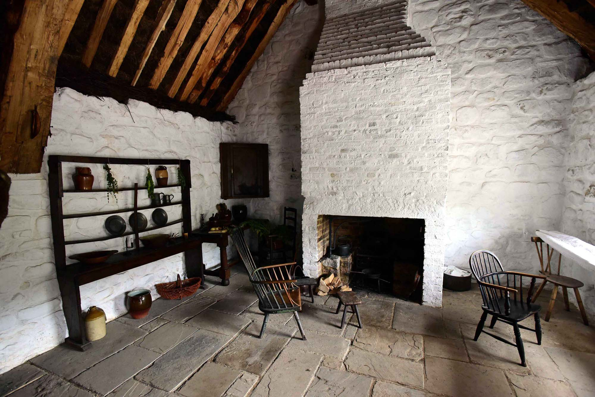 photo of an interior of a simple stone cottage