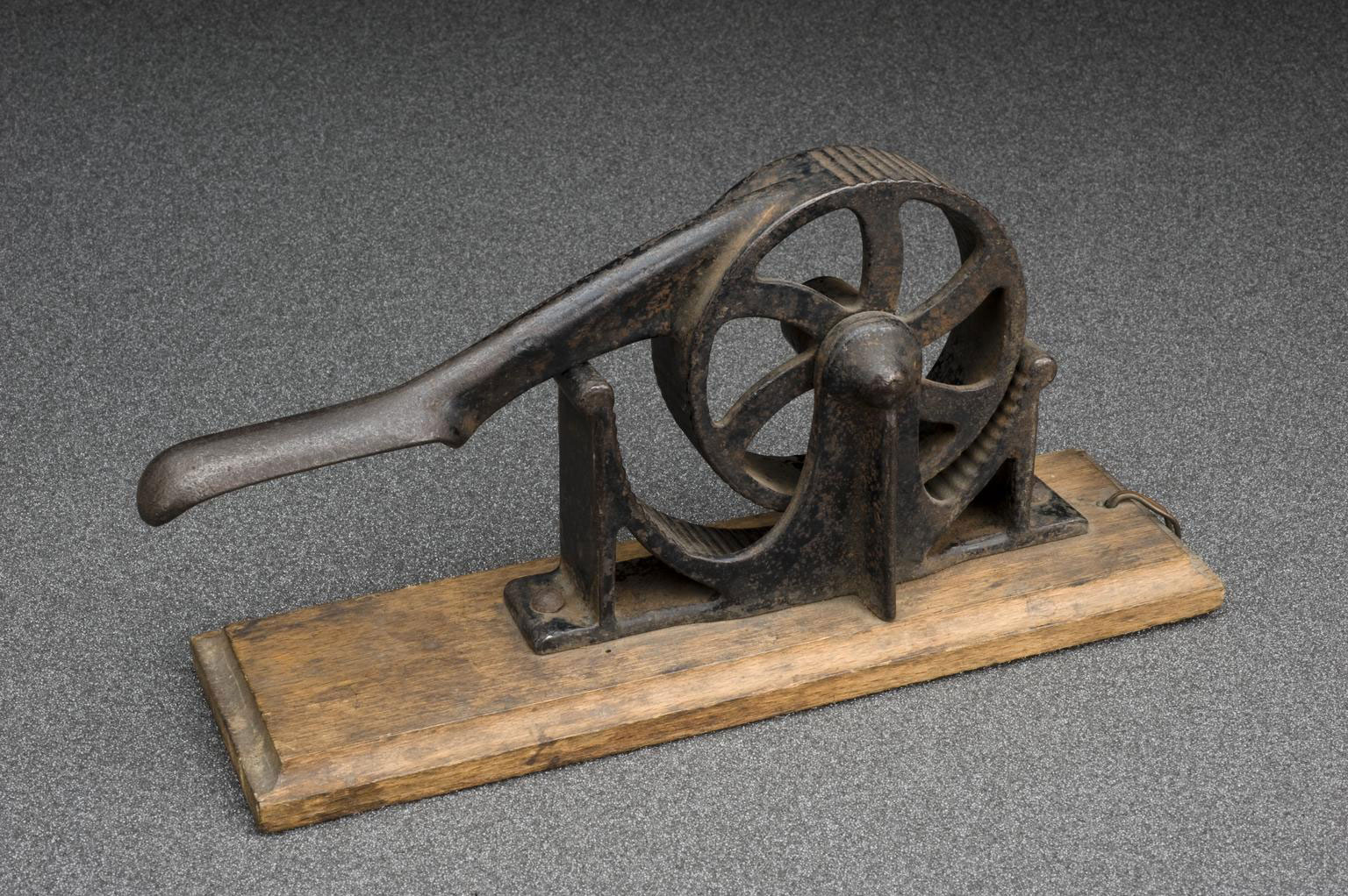 photograph of a machine with ridges and hand crank