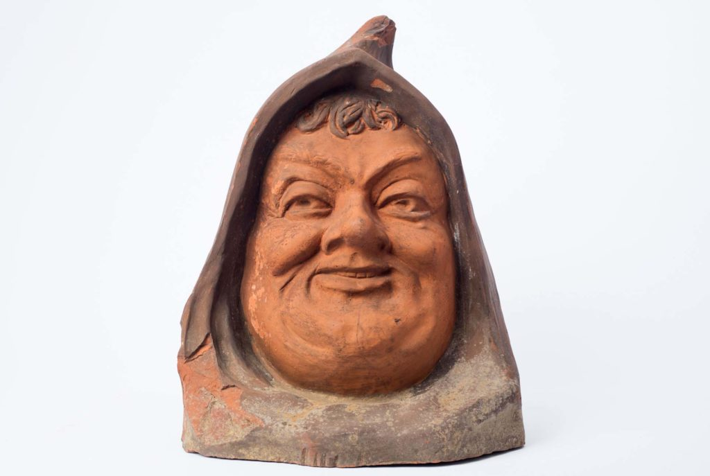 a photo of a ceramic hooded monk's head