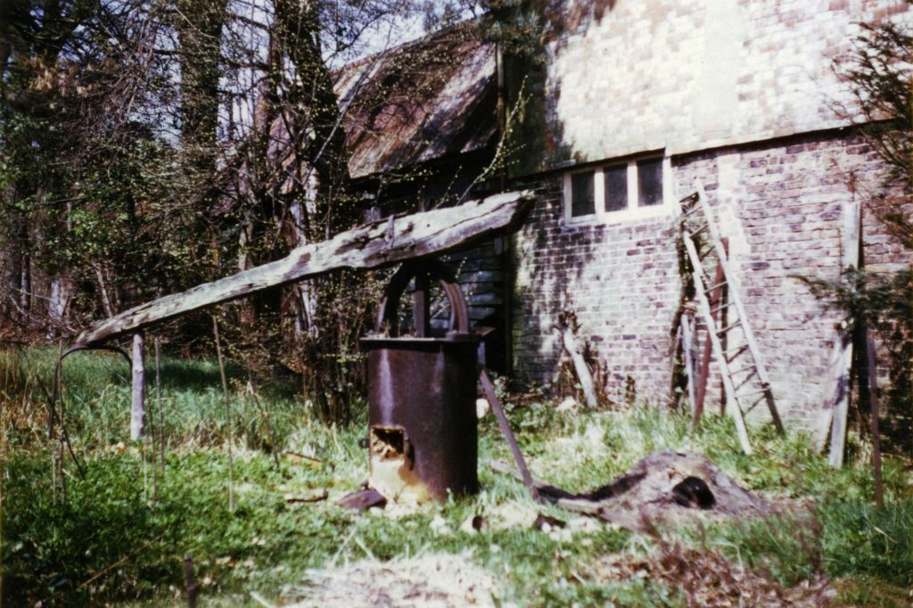 an old colour photo of a semi-derelict building