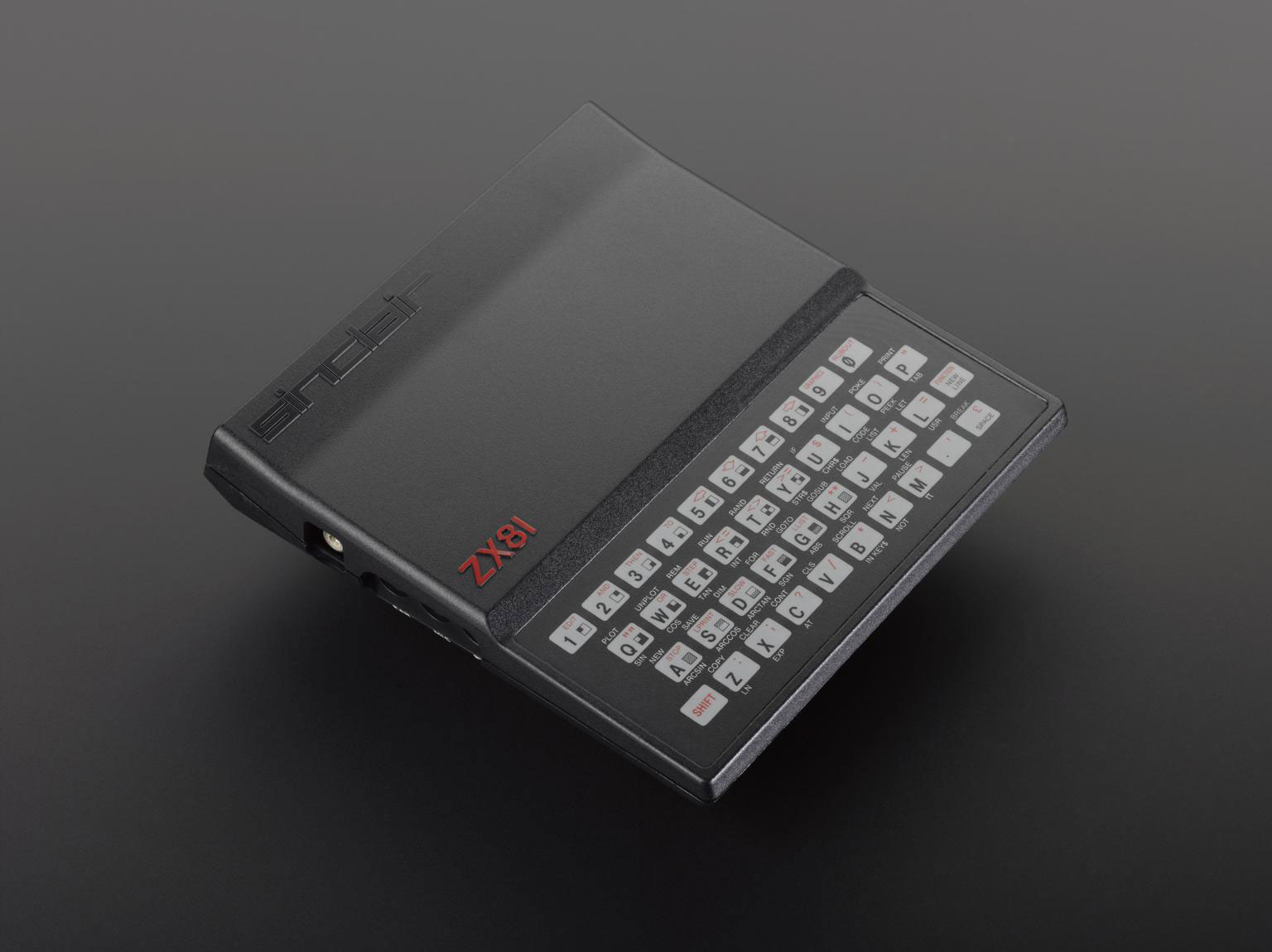 photograph of sinclair ZX81 computer - a black box with a keyboard