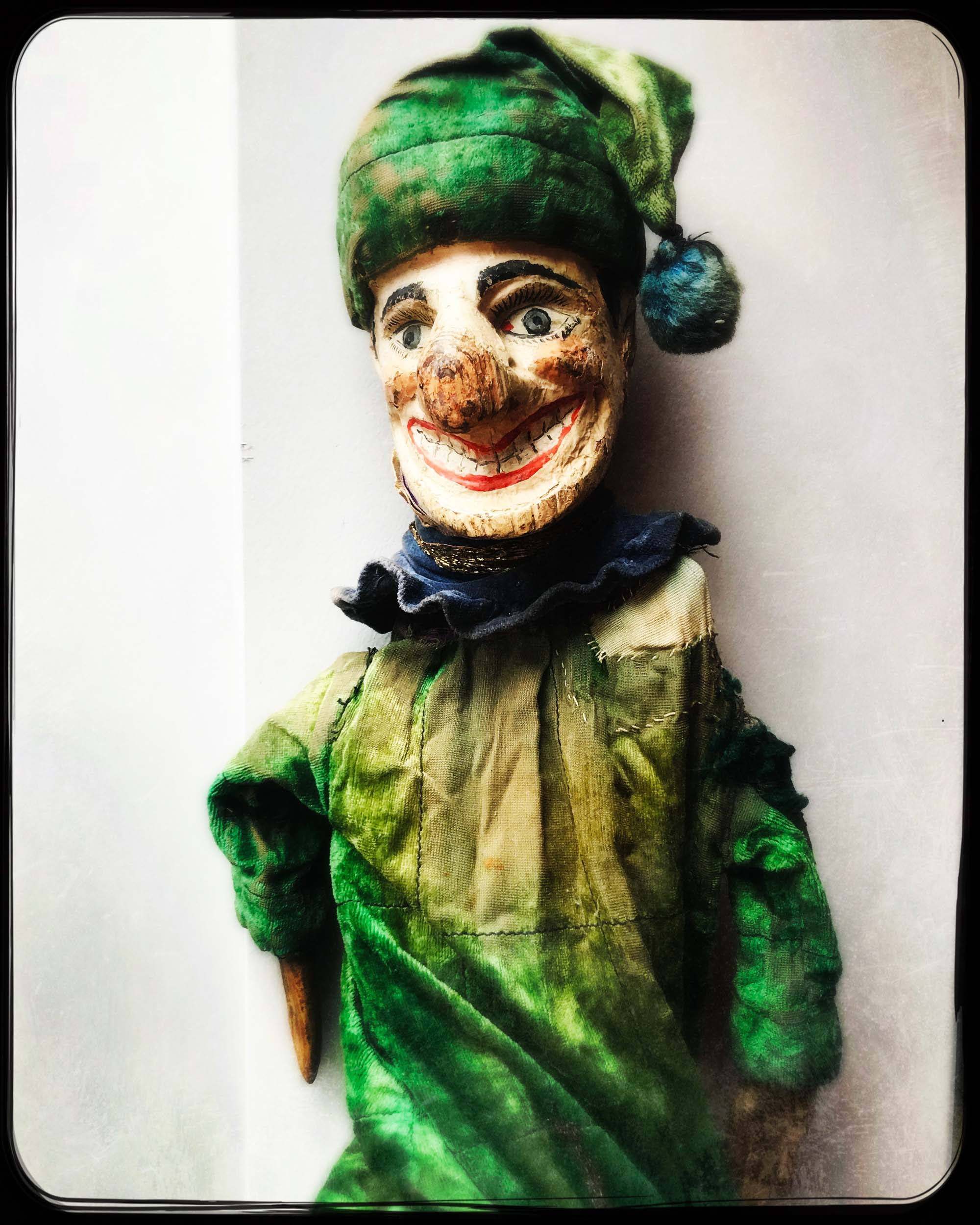 a photo of a Mr Punch character dressed in green