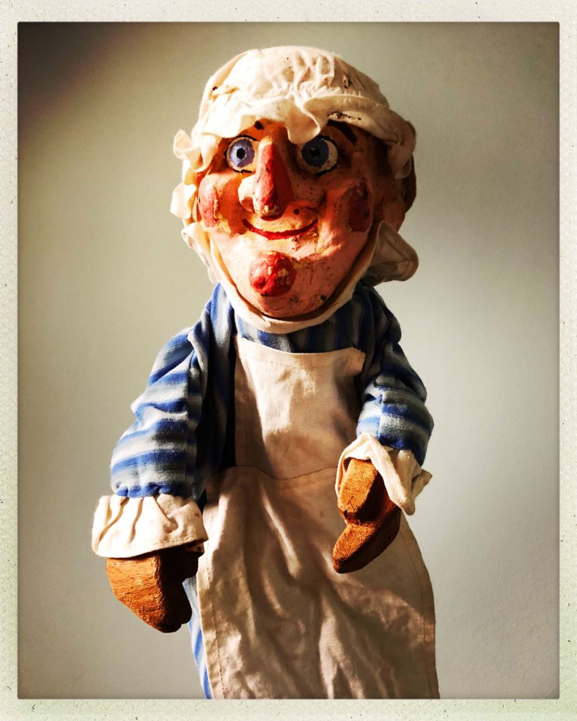 Photo of a judy puppet with cloth cap and apron