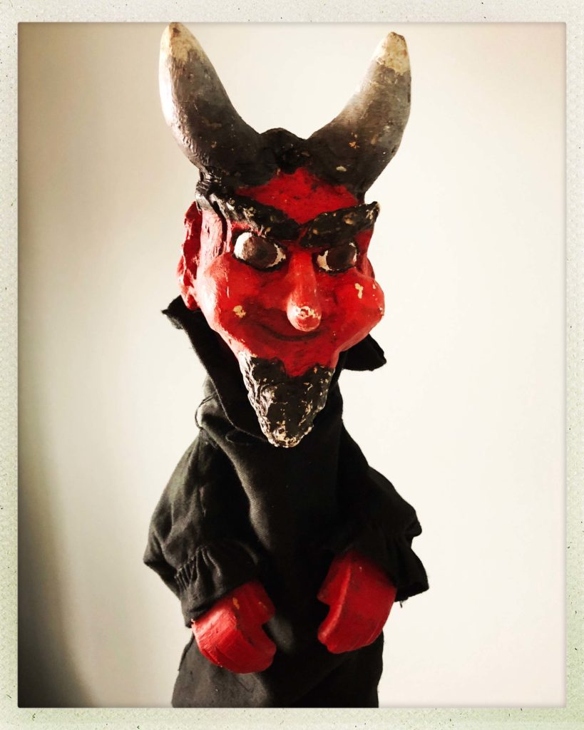 photo of a puppet devil character