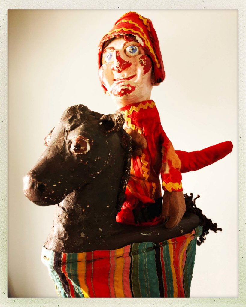 a photo of a punch puppet character on a hobby horse