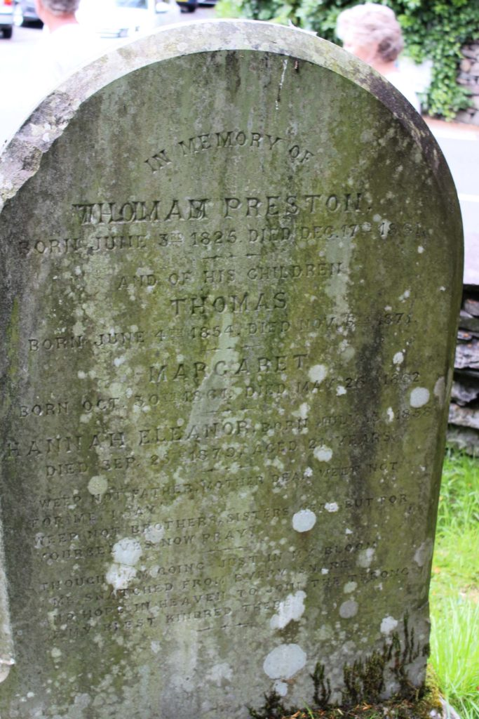 a tombstone with several members of the Preston family carved into it.