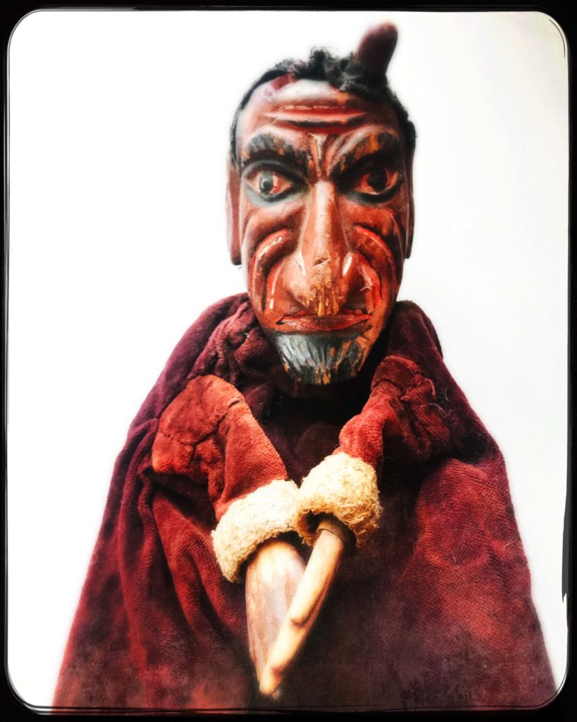 a photo of a devil puppet character