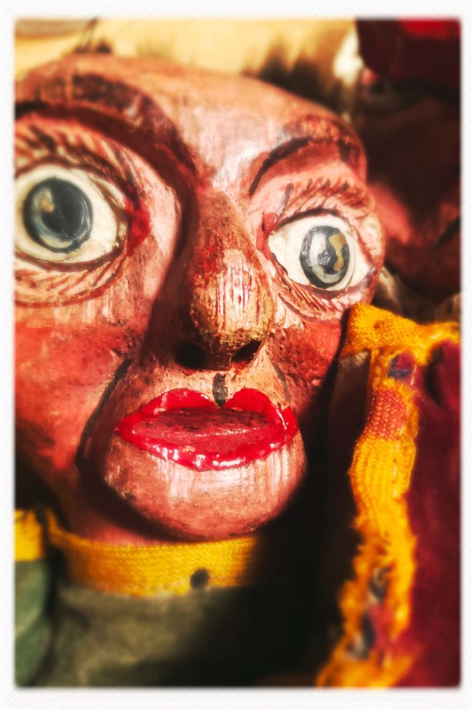 a close up a wooden puppet character's head