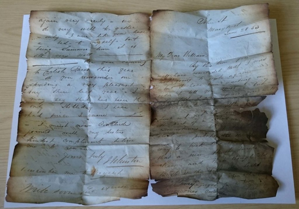 a photo of a folded, scorched handwritten letter